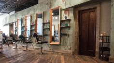 The salon takes great pride in its space, showcasing modern patterns, rustic textures and custom-built styling stations.