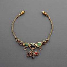 Hellenistic Gold Butterfly Necklace  --  2nd Century BCE  --  Gold, garnet & emerald  --  Via Phoenix Ancient Art