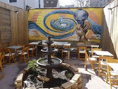 I like the idea of hiring local artists to do murals on an out door seating area.