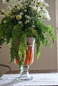 Love this carrot/daisy centerpiece for an Easter table.