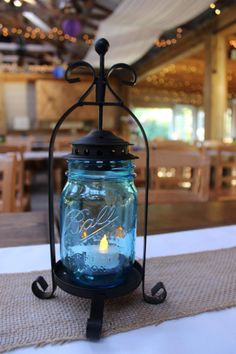 These iron candle holders hold our blue pint mason jars as well as clear and green ones-@ Khimaira Farm outdoor barn wedding venue Shenandoah Valley Blue Ridge Mountains Luray VA
