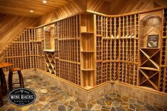 One of the most gorgeous wine cellars we have designed. The redwood tongue and groove paneling on the walls and ceiling really ties the cellar together. The stone floor and tile ledge create a unique, clean look while adding height to the racking. Beautiful!!