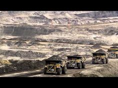 """Mining lorries carry loads of tar sands in Alberta, Canada. One climate scientist warned that it would be """"game over"""" for efforts to stop global warming if Canada's tar sands were fully exploited. Facts About Canada, Xl Pipeline, Oil Sands, Government Of Canada, Atlantic Canada, Church Of England, World Leaders, Natural Resources, Global Warming"""