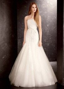 """Absolutely stunning satin and organza fit-and-flarewedding dresswith sequin detailing and satin sash.  Strapless fit and flare satin and organza gown features sequin detailing on bodice and full tulle skirt.  Removable satin sash is included.  Available in stores and online in Sterling and Ivory.  Sizes 0-14 available in stores and online. Plus sizes are available in stores for special order up to size 26.  Sweep train 60"""" from natural waist.  Fully lined. Center back zip. Imported.…"""