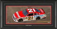 Trevor Bayne Framed Mini Panoramic with Facsimile Signature by Mounted Memories. $90.99. This NASCAR mini panoramic collectible features an 8x20 photo of Trevor Bayne's number 21 race car.  It comes double matted and framed in black wood and includes Trevor's facsimile signature. Officially licensed by NASCAR.  Measures 15x27 and comes ready to hang in your home or office.