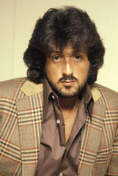 Sylvester Stallone.....my husband looked so much like this pic of Sly Stallone in the 1970's.  Everybody called him Sly.  Exact hair style.....Gorgeous!