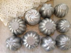 vintage aluminum molds. have a bunch of these to use as decoration.