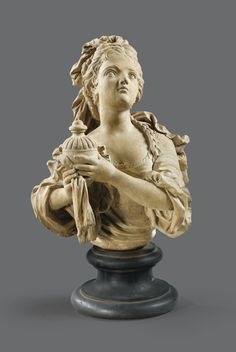 A FRENCH, CIRCA 1730, TERRACOTTA BUST DEMI NATURE OF ADRIENNE LECOUVREUR IN THE ROLE OF CORNÉLIE, AFTER A MODEL BY CHARLES-ANTOINE COYPEL (1694-1752), ON A BRONZE BASE