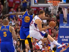 Description of . Los Angeles Clippers forward Blake Griffin, right, puts up a shot as Golden State Warriors forward Draymond Green, center, defends and forward Marreese Speights looks on during the second half in Game 7 of an opening-round NBA basketball playoff series, Saturday, May 3, 2014, in Los Angeles. (AP Photo/Mark J. Terrill)