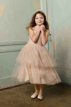 Fun yet vintage-looking tulle flower girl dress.