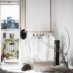 DIY clothes rail with leather strings and a wooden rod. Funky Home Decor, Easy Home Decor, Home Decor Styles, Beautiful Interior Design, Beautiful Interiors, Diy Clothes Rail, Stockholm, Salons Cosy, Paris Bedroom