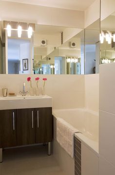 Awesome, effective trick to enlarge this small space as well as bounce more light around the room.  bathroom by Celia James [Work it]