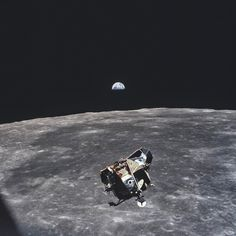 Apollo 11 moon-walkers in ascent stage of the Lunar Module, returning to Command Module, 1969.  Taken by astronaut Michael Collins, who's waiting for them.