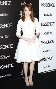 Emma Stone arrives at the Essence luncheon in Beverly Hills, Calif.