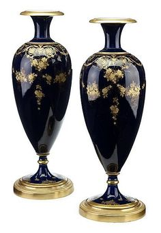 Pair of Limoges cobalt and gilt decorated porcelain urns   early 20th century