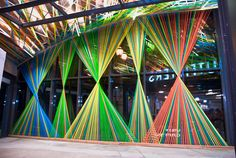 urban outfitters window display.. Could be a paper streamer/ ribbon job for an insta-promo backdrop