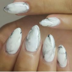 almond shaped, B&W marble. Useful for; adding something more to an outfit to make it classy, all while making the outfit more interesting.