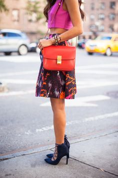 Bright crop top + printed skirt + lace-up stilettos + bold bag