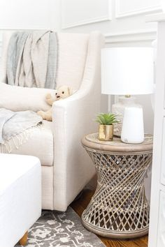 An all white nursery makeover room reveal with classic, vintage style furniture, Anthropologie-inspired patterns and textures, and floral accents. Wicker Side Table, Side Table Decor, Modern Side Table, Side Tables, Side Table Lamps, White Nursery, Floral Nursery, Nursery Room, Nursery Lamps