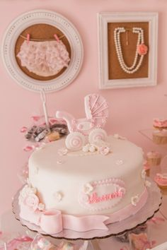Beautiful baby shower cake featuring a fondant carriage! #babyshower #cake