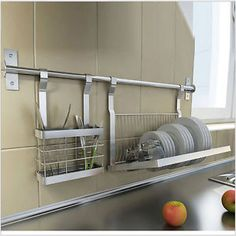 Ikea metal shelf and fold away dish dryer storage rack by for Ikea plate storage
