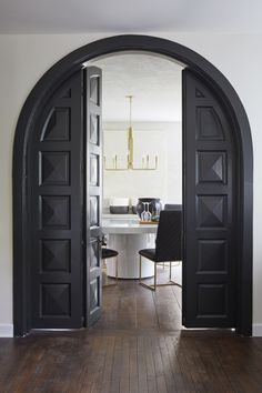 "Leanne Ford Interiors for HGTV's ""Restored By The Fords"" - The McCalister Project - Construction by Steve Ford - Shot by Reid Rolls House, Interior, Arched Doors, Home, Farmhouse Remodel, Doors Interior, House Interior, Dark Interiors, White Interior Design"