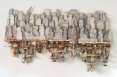 Luke O'Sullivan uses a combination of drawings and sculptural carvings to construct wondrous urban landscapes. His extensive metropolitan pieces strike a balance between recognizable architecture and impossible structures in order to create fantastical subterranean systems. The 3-D artworks prot