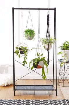 Use a garment rack and a few S-hooks to display your hanging plants.