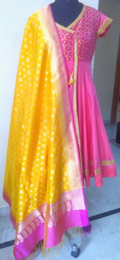 Beautiful banarasi dupatta paired with pretty pink angrakha.