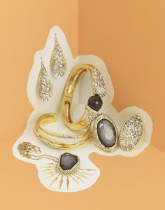 Bela Borsodi, Photographer - Intermix  DC:  Make paper shape like running water/waterfall/raindrops on which to put jewelry