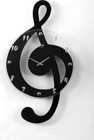 Relógio de ponteiro em forma de nota musical