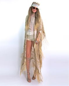 "Soooooooo GOOD!  Gorgeous velvet burnout caftan with a Baroque floral pattern and silk fishnet fringe all along sides and bottom.   Great with anything and everything year round! So many ways to wear and style, dressed up or down, simply effortless and timeless!  Color: Desert SandOne size fits allTotal length including fringe is 51""The velvet burnout process, or ""Dévoré"" as it is also referred, is achieved by applying an acid to a natural, protein fib..."