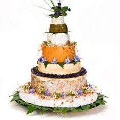 Not got a sweet tooth? Why not make your cake the talking point amonst your guests and go for something different - Cheese!! Serve up with Crackers and decorate with fruits and flowers! Perfect! Note to self - May not be the best option if you are looking for your cake to be on display for the whole day!