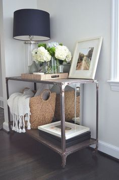 Entryway decor...tray filled with vases, basket, plush throw