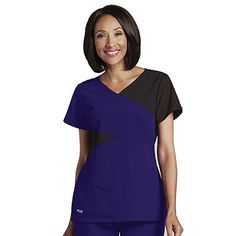 Asymmetrical panels give the Signature by Grey's Anatomy™ Women's Mock Wrap Colorblock Solid Scrub Top a modern look. Performance fabric and multiple pockets provide the qualities you need in a scrub top.