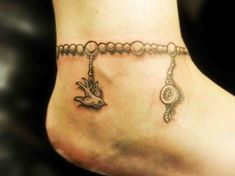 Here we have nice picture about charm anklet tattoo designs. We wish these photos can be your buoyant. Ankle Tattoo Designs, Ankle Tattoo Small, Small Wrist Tattoos, Charm Anklet Tattoo, Anklet Tattoos, Tatoos, Garter Tattoos, Rosary Tattoos, Tattoo Tights