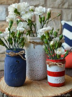 Make use of your extra mason jars by filling a trio with delicate flowers. Coat them with patterned shades of red, white and blue.
