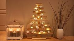 homemade wooden Christmas tree decorated with star Christmas lights Palette Christmas Tree, Pallet Christmas, Wooden Christmas Trees, Christmas Home, Cheap Christmas, Christmas Ideas, Merry Christmas, Christmas Tree Decorations To Make, Star Christmas Lights