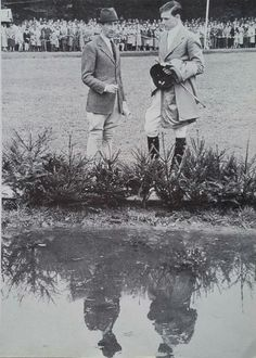 "Bert De Nemethy and Hugh Wiley walking a course during a competition in Cologne, Germany, 1956. This photo was found on the facebook page, ""Hunters & Jumpers: The First 90 Years,"" however it also appeared in the ""USET Book of Riding."""