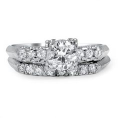 This platinum matched set from the Art Deco era is truly classic, with a beautiful round brilliant diamond centered between six single cut diamond accents on the engagement ring and additional sparkling diamonds on the wedding band (approx. 0.70 total carat weight).