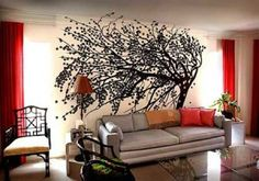 *Love* this mural--especially with the pops of red in the room.