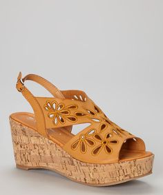 Take a look at the Tan Cutout Zurich Wedge Sandal on #zulily today!