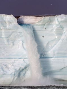 The Austfonna glacier waterfall in Svalbard, Norway, crashes 160 feet into the ocean in this awe-inspiring image