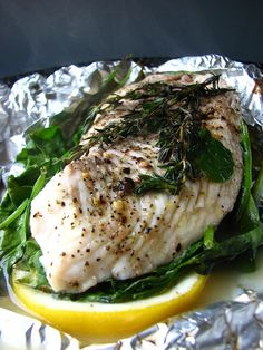 Tilapia, spinach, lemon, and thyme - cooked in foil