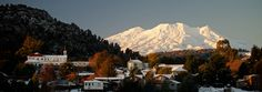 Ohakune, at the base of Mt Ruapehu (North Island, New Zealand) is beautiful summer and winter.  Make sure you get a room with a view of that beautiful mountain - when it's lit up at night for the ski fields, it truly is magical.