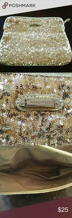 Nine West Sequins Bag (Gold) This Nine West Sequin Bag is an added addition to piece of your day.... I used it for my Ipad, as my clutch at times..And I used as I added piece for my purse.... Nice accessory piece!!!! Preowned ***** No Trades please... Nine West Bags