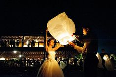 The Bride and Groom light up the night sky with a wish - our wedding lantern packages can be a focal part of a wedding. See http://www.wishlantern.com/wedding-wish-lantern-packages