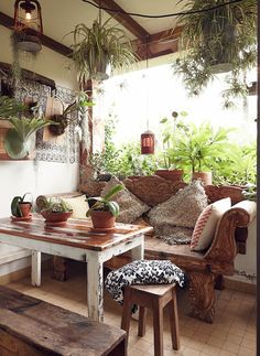 In a bohemian space, the most prized pieces of furniture are those with history, such as a hand-carved bench or a well-loved vintage find. The cozy indoor-outdoor room above was created by Dion Antony Design and was featured on The Grace Tales.
