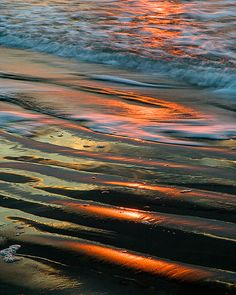 ~~Sandy Sunrise ~ the rising sun combined with an incoming ripple of water taken on a remote beach in North Carolina by LightOfTheWild~~