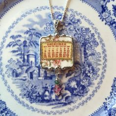 Dishfunctional Designs The original contemporary jewelry handcrafted from broken vintage china...  Handcrafted from: an antique calendar